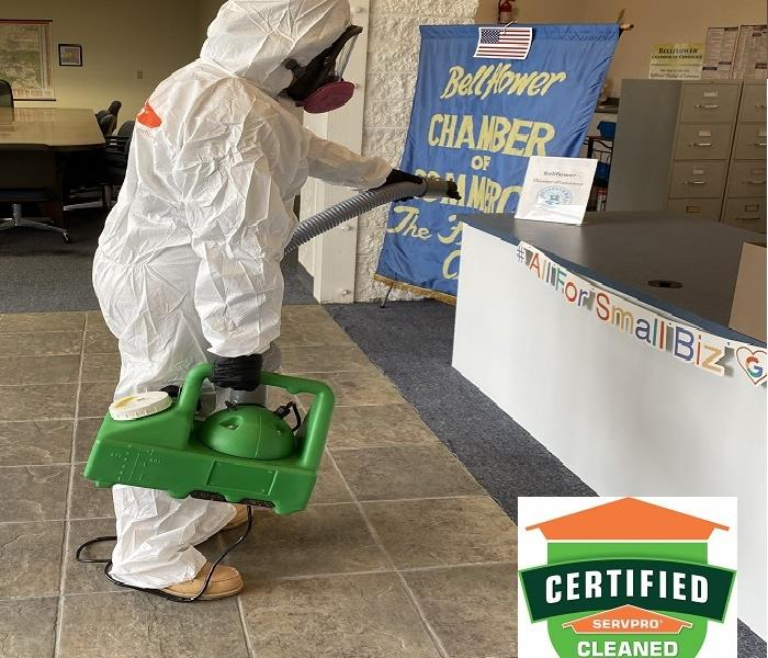 Employee in PPE Cleaning & Disinfecting