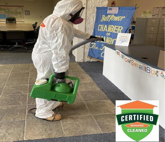 Certified: SERVPRO Cleaned - image of employee in PPE fogging a space